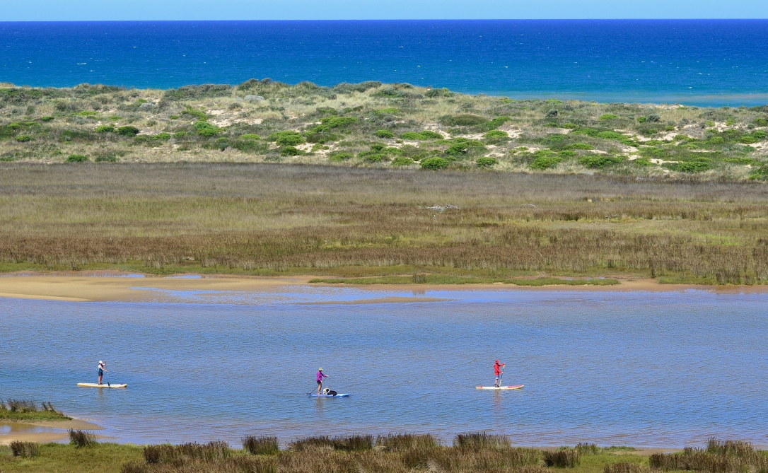 Annie, Leanne and Rob cruising in the beauty of Snowy River Estuary, Marlo, East Gippsland, Victoria, Australia.